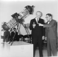 Ralph and Preston examine light source for Ralph\'s planetarium projector. Exact date unknown, probably early to mid 1960s.