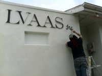 Frank Flandorffer touches up our sign. Photo by Wendy Cicion