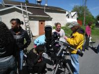 LVAAS Member Estelle Hines explaining the current activity of the sun as students look through the white light and hydrogen-alpha solar telescopes.