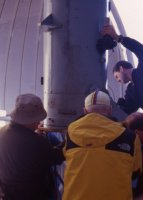 Crew removing the 20-inch primary mirror for refiguring, March, 1998