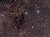 LDN 673  dark nebula  in  Aquila. The nebula is superimposed upon the clouds and stars of the Milky Way.