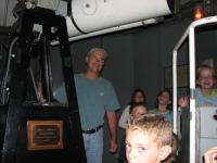 "Bill Dahlenburg explains the workings of the 12"" cassegrain to a group of youngsters at the Sept 9th \'06 star party."