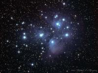 """The Pleiades star cluster in Taurus. This is my third attempt at this target in the past 6 years and I think I finally nailed it. There is another shot I took a couple of years ago in which I ended up with weird halos around the dimmer stars. It's still in this gallery if you'd like to compare.  Taken @ Cherry Springs State Park the morning of 10-08-2010.  The details: William Optics  Zenithstar 80; TeleVue Flattener/Reducer; QSI583wsg; Baader LRGB filters. Guided off axis with a Starlight Xpress Lodestar guider on a CGE mount. LRGB luminance 16 @ 5 minutes each binned 1x1, RGB 10 each @ 2 minutes binned 2x2. Aquired in AstoArt. Calibrated and stacked  in Deep Sky Stacker. Processed in Photoshop. Diffraction spikes added with """"Star Spikes Pro"""" (my apologies to the purists)"""