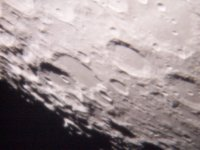 this is a 11day old moon. it was taken through the 12 inch [cass] at south mountain. i used a 32mm eyepiece and a dx7440 camera. seeing was poor and i had high clouds.